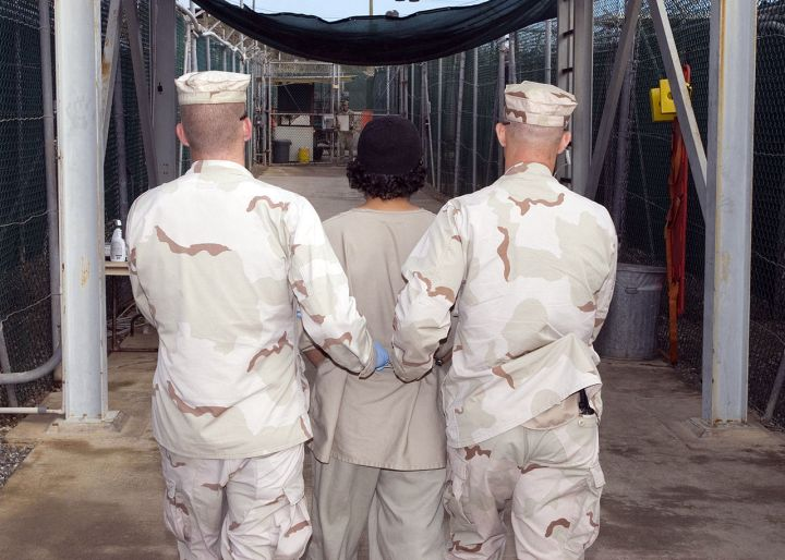 1280px-Captive_being_escorted_for_medical_care_December_2007.jpg